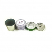 different sizes tinplate pressitin tin cans with labels and stickers